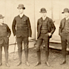 Four men posing as mashers